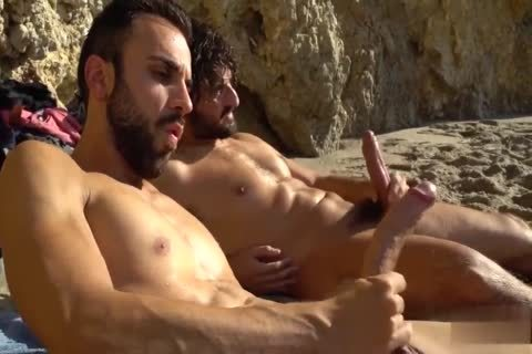 massive penises jerking off AT THE BEACH