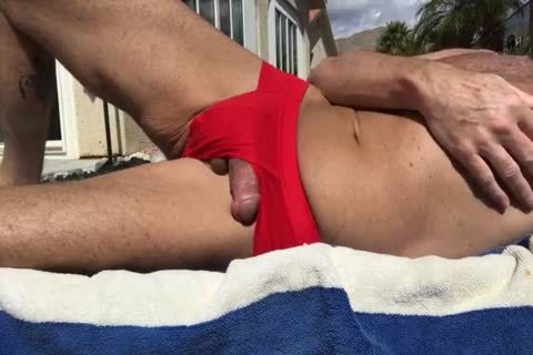 SUNBATHING WITH HARD wang OUT AND wanking