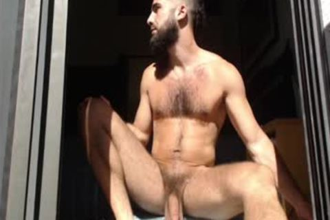 Bearded boy Massages his nuts